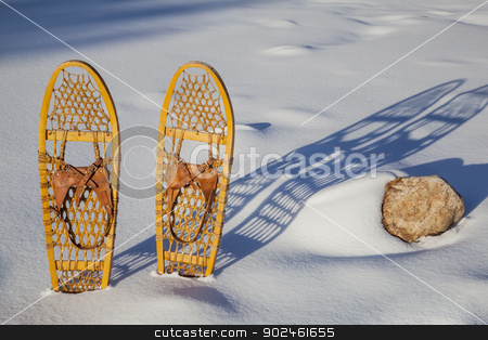 Bear Paw classic snowshoes stock photo, a pair of classic Bear Paw wooden snowshoes cast shadow in snow by Marek Uliasz