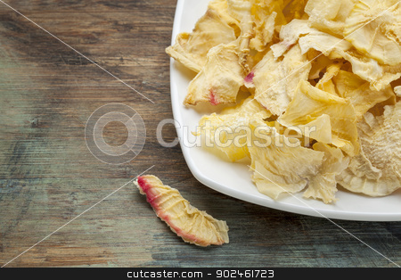 yacon chips stock photo, Dried slices of yacon tuber on grunge painted wood. Yacon contains inulin, a complex sugar, which promotes healthy probiotics. by Marek Uliasz