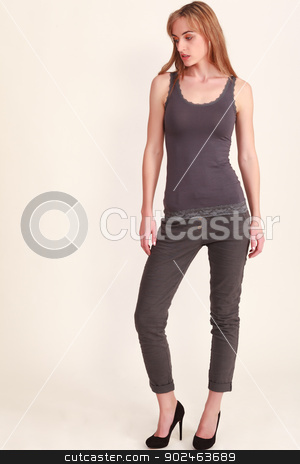Style Note stock photo, Young woman with a slender figure in outfit by Roland Stollner