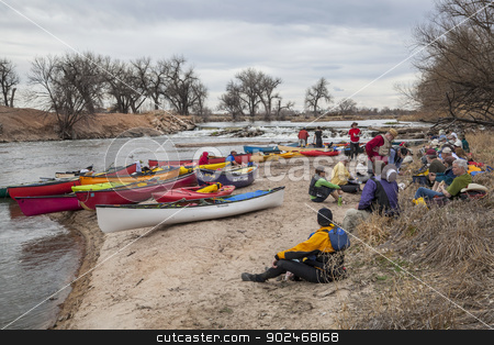 paddling lunch break  stock photo, SOUTH PLATTE RIVER, EVANS, COLORADO - APRIL 6: Paddlers are taking a lunch break during Annual All Club Paddle on April 6, 2013. It is a popular season opening paddling trip in northern Colorado. by Marek Uliasz