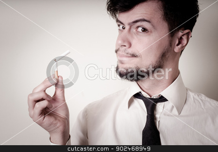 businessman stop smoking stock photo, businessman stop smoking on gray background by Eugenio Marongiu