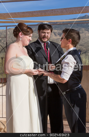 Cute Lesbian Couple Marriage stock photo, Cute lesbian couple in civil union with Jewish Rabbi by Scott Griessel