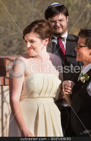 Cheerful Bride with Partner stock photo, Cheerful European woman with bride and rabbi outdoors by Scott Griessel