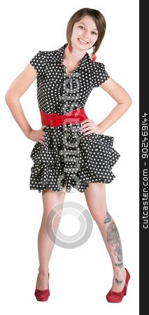 Cute Woman Dancing stock photo, Cute young woman in polka dot dress dancing by Scott Griessel