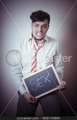 businessman with a blank blackboard write sex stock photo, businessman with a blank blackboard write sex on gray background by Eugenio Marongiu