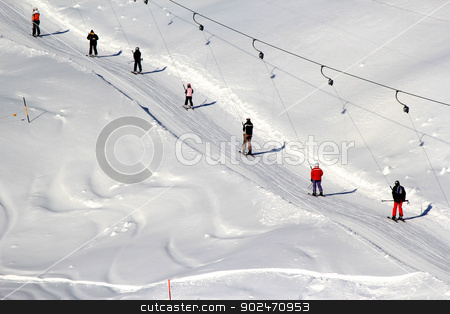 Alpine skiing lift stock photo, Guys on the ski mountains in Switzerland by Dmelnikau