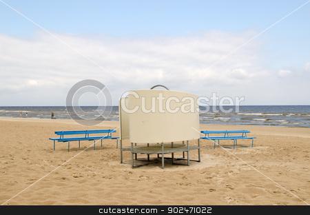 blue wooden bench change cabin sea beach people  stock photo, two blue wooden benches near wear changing cabin on sea ocean beach sand and people recreate seaside.  by sauletas