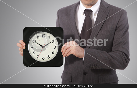 time in hands stock photo, business man with wall clock on his hand, grey background by matteo bragaglio