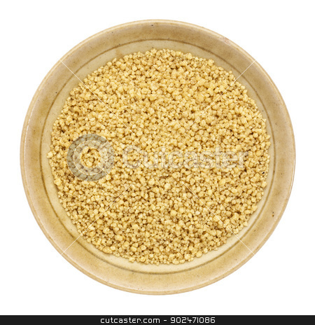 whole wheat couscous stock photo, whole wheat couscous in a small ceramic bowl isolated on white, top view by Marek Uliasz