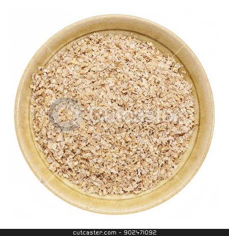wheat bran stock photo, wheat bran in a small ceramic bowl isolated on white, top view by Marek Uliasz