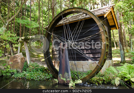 Water mill stock photo, Small Japanese water mill running in the Expo Commemorative Park, Osaka by Andreas Altenburger