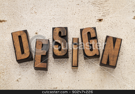 design word in wood type stock photo, word design spelled in vintage letterpress wood type blocks on a rough white painted barn wood background by Marek Uliasz