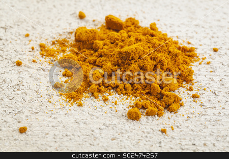 turmeric powder stock photo, turmeric powder on a white painted rough barn wood surface by Marek Uliasz