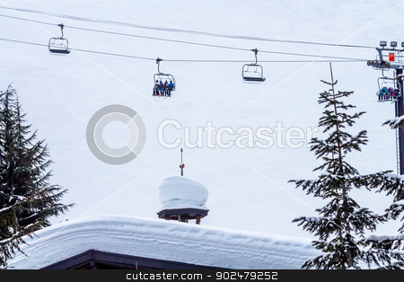 Skiing Chairlift Againt Snow Mountain Alpine Building at Snoqual stock photo, Skiing Chairlift Skiers Against Snow Mountain Alpine Building at Snoqualme Pass Washington. by William Perry