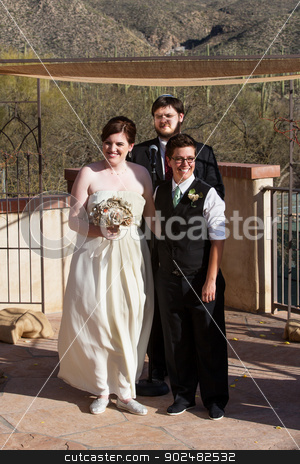 Happy Married Couple stock photo, Happy lesbian couple at civil union with rabbi by Scott Griessel