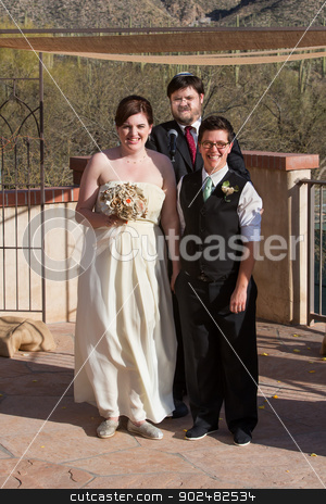 Gay Married Couple Outdoors stock photo, Smiling gay couple at wedding with rabbi by Scott Griessel