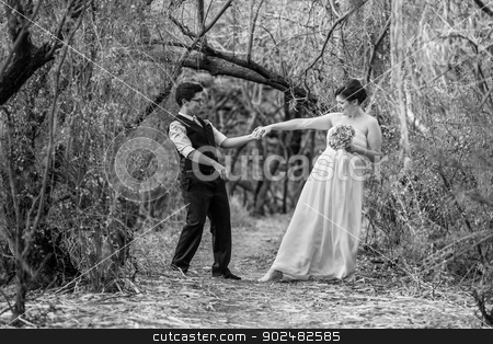 Committed Couple Dancing Together stock photo, Happy committed couple dancing in the forest together by Scott Griessel
