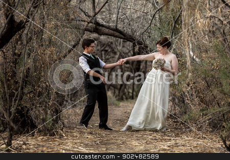 Fun Couple Dancing Together stock photo, Married same sex couple dancing in the forest together by Scott Griessel