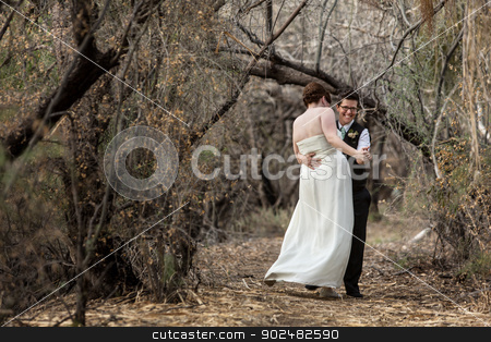 Newlyweds in Fun Dance stock photo, Laughing white Lesbian couple dancing in a forest by Scott Griessel