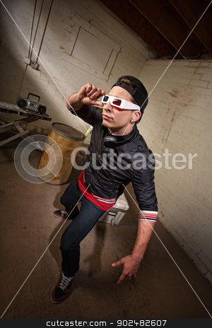 Man Looking Through 3D Glasses stock photo, Cool hip hop white guy with 3D glasses indoors by Scott Griessel
