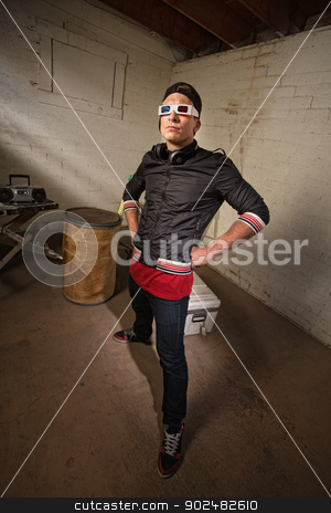 Cool Rapper in Basement stock photo, Posing Caucasian rapper in basement with hands on hips by Scott Griessel