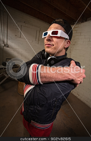 Grinning Rapper with 3D Glasses stock photo, Funny man with folded arms and 3D glasses by Scott Griessel