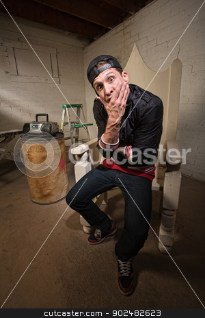 Surprised Rapper in Throne stock photo, Dumbfounded European rapper sitting on throne holding chin by Scott Griessel