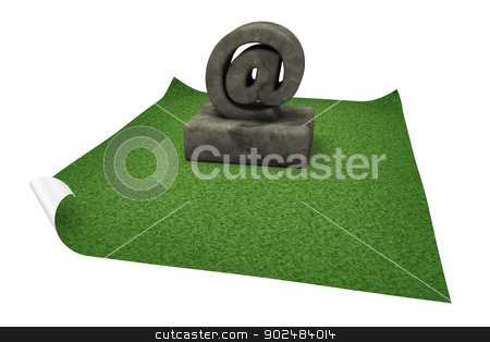 stone email symbol stock photo, stone email symbol on grass isle - 3d illustration by J?