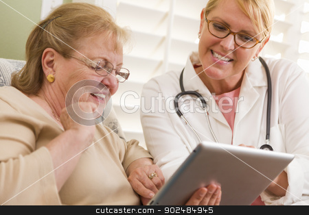 Doctor or Nurse Talking to Senior Woman with Touch Pad stock photo, Doctor or Nurse Talking to Senior Woman with Touch Pad Computer. by Andy Dean