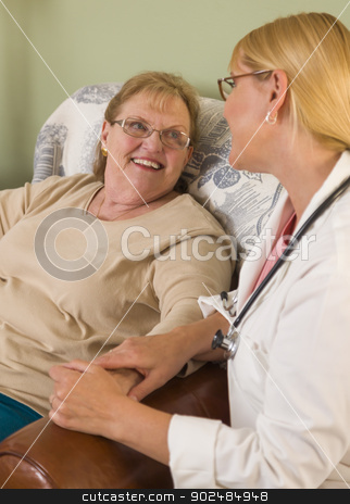Doctor or Nurse Talking to Sitting Senior Woman stock photo, Happy Smiling Doctor or Nurse Talking to Senior Woman in Chair. by Andy Dean