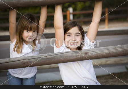 Pretty Young Sisters Portrait Outside stock photo, Pretty Young Children Sisters Portrait Outside. by Andy Dean
