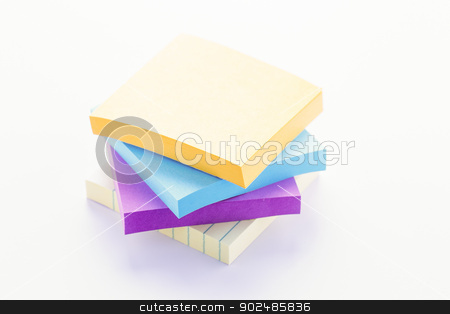 Sticky Note Pads stock photo, Stack of colorful sticky note pads on white by Darryl Brooks