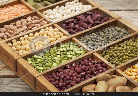 legume abstract stock photo, assorted legumes: green, red and French lentils, soybean, green and yellow pea, fava bean, kidney, mung, adzuki bean  in a wooden box by Marek Uliasz