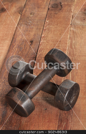 vintage iron dumbbells stock photo, a pair of vintage iron rusty dumbbells on red barn wood background - fitness concept with nostalgic mood by Marek Uliasz
