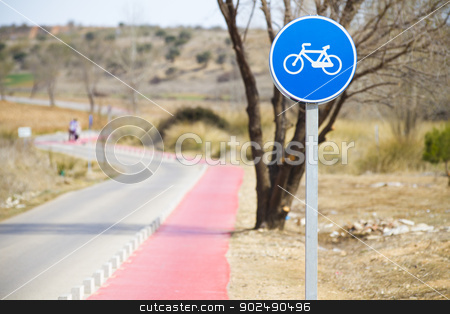 Bicycle lane with white bycicle sign, rural and natural scene  stock photo, Bicycle lane with white bycicle sign, rural and natural scene by Fernando Cortes
