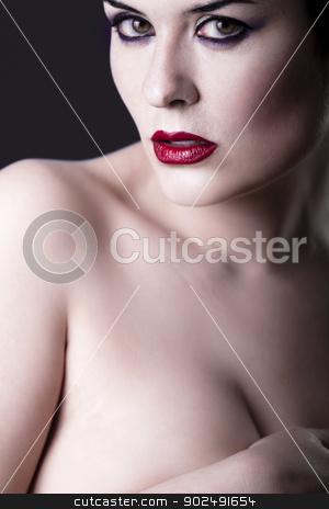 Sensual beautiful nude brunette girl over dark backdrop, caucasi stock photo, Sensual beautiful nude brunette girl over dark backdrop, caucasian woman by Fernando Cortes