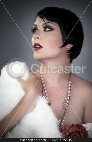 sensuous short haired brunette woman, bare shoulders with white  stock photo, sensuous short haired brunette woman, bare shoulders with white fur, flirty, beautiful, sweet, 20s flapper hollywood style by Fernando Cortes