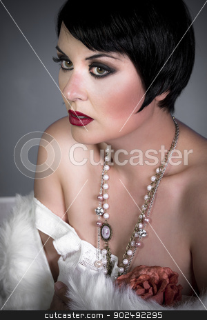 sensuous short haired brunette woman, bare shoulders with white  stock photo, sensuous short haired brunette woman, bare shoulders with white fur, flirty, beautiful, sweet, 20s old hollywood by Fernando Cortes