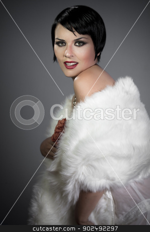 sensuous short haired brunette woman, bare shoulders with white  stock photo, sensuous short haired brunette woman, bare shoulders with white fur, flirty, 20s hollywood style by Fernando Cortes