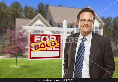 Male Real Estate Agent in Front of Sold Sign and House stock photo, Male Real Estate Agent in Front of Sold Home For Sale Sign and House. by Andy Dean