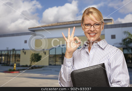 Businesswoman In Front of Vacant Office Building stock photo, Smiling Businesswoman with Okay Sign In Front of Vacant Office Building. by Andy Dean