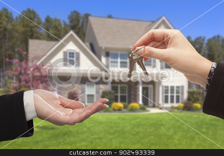 Agent Handing Over the House Keys in Front of New Home stock photo, Real Estate Agent Handing Over the House Keys in Front of a Beautiful New Home. by Andy Dean