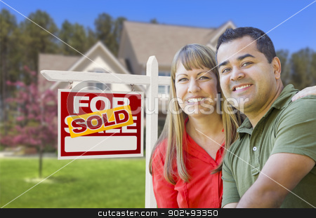 Couple in Front of Sold Real Estate Sign and House stock photo, Happy Mixed Race Couple in Front of Sold Home For Sale Real Estate Sign and House. by Andy Dean