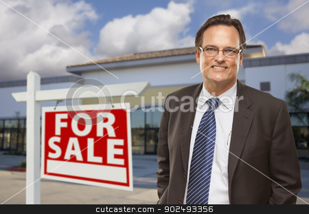 Businessman In Front of Office Building and For Sale Sign stock photo, Handsome Businessman In Front of Vacant Office Building and For Sale Real Estate Sign. by Andy Dean