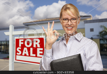 Businesswoman In Front of Office Building and For Sale Sign stock photo, Smiling Businesswoman with Okay Sign In Front of Vacant Office Building and For Sale Real Estate Sign. by Andy Dean