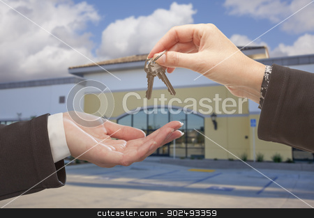 Agent Handing Over the Keys in Front of Business Office stock photo, Real Estate Agent Handing Over the Keys in Front of Vacant Business Office. by Andy Dean