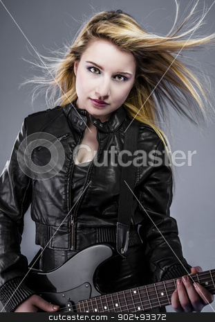 Blonde, Beautiful young woman dressed in black rock with electri stock photo, Blonde, Beautiful young woman dressed in black rock with electric guitar by Fernando Cortes