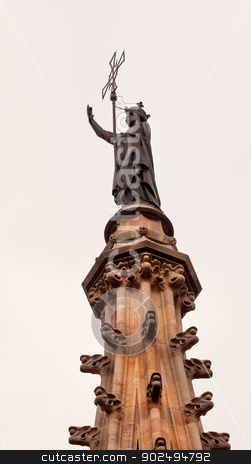 St Eulalia Statue Spire Catholic Barcelona Cathedral Catalonia S stock photo, St Eulalia Statue Top of Main Spire Catholic Barcelona Cathedral Catalonia Spain.  Built in 1298.  St Eulalia is a 4th Century Marytr, who is buried in the Cathedral. by William Perry