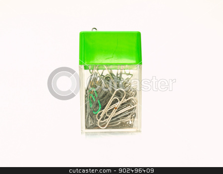 Used metal paper clips in used plastic container isolated on whi stock photo, Used metal paper clips in used plastic container by gururugu