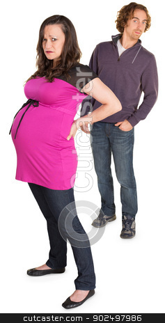 Naive Father with Mother stock photo, Moping pregnant woman with naive man with hands in pockets by Scott Griessel